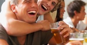 Smiling_young_guys_laughing_joyfully_beer_bar_0